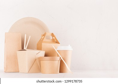 Mockup food takeaway packaging for cafe and restaurant -   blank container, box, bowl for food, drink, packet, chopsticks of brown paper on white wood table.