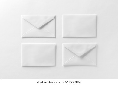 Mockup of four envelopes at white textured paper background.