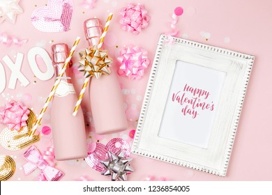 Mockup frame with bottles of champagne,  confetti and decorations. Valentines day or birthday party concept theme. Flat lay, top view