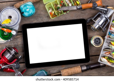 mockup frame fishing tackles and fishing baits in box on wooden board background. Design for adventure sport business - templates, web, poster, card, advertisement.