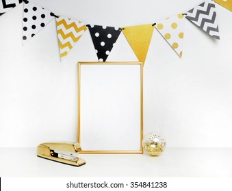 Mockup frame. Gold decoration. Gold frame and stapler. Festival flags, polka and chevron patterns