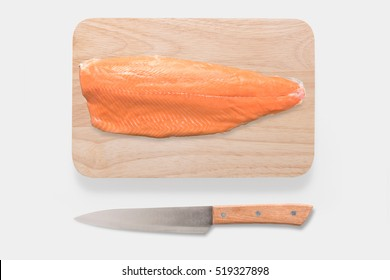 Mockup fresh salmon and knife on cutting board set isolated on white background. Clipping Path included on white background. Top view.