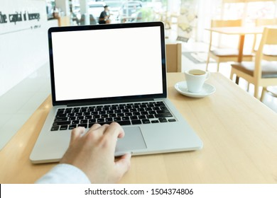 mockup image blank screen computer  with white background for advertising text,hand man using laptop on desk contact business search information on desk in office.design creative work
