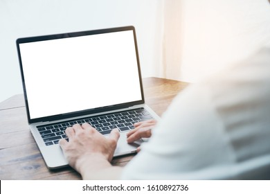mockup image blank screen computer with white background for advertising text,hand man using laptop contact business search information on desk at coffee shop.marketing and creative design