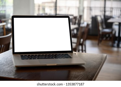 Mockup image of business Laptop with blank screen on table blank copy space screen for your advertising text message