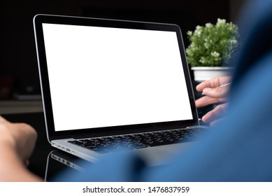 Mockup image of business man working on blank screen laptop, computer on table, typing on keyboard, networking in modern office for website or application design, close up, over shoulder view