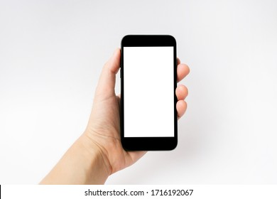 Mockup image of hand holding black mobile phone with blank white screen.