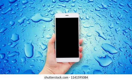 Mockup image of hands holding white mobile phone with blue Water Drops background