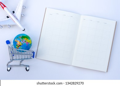 Mockup image of weekly planner notebook, shopping cart,global world model and airplane design template isolated on white background. Business trip and travel, holiday and vacation concept.