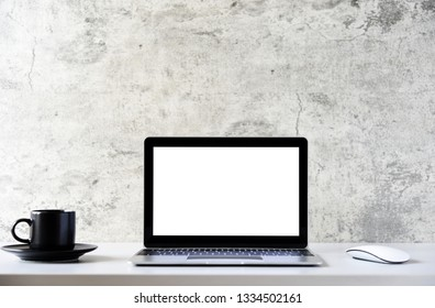 Mockup Laptop computer with blank screen front view work table Office,Copy space