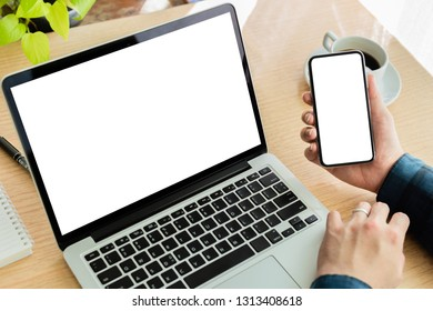 mockup laptop,cell phone.businessman partner searching information in workplace Think business  contact investment plan with laptop computer,cell phone,on desk in office.design creative work space