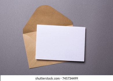Mock-up letter or postcard with envelope on a gray background