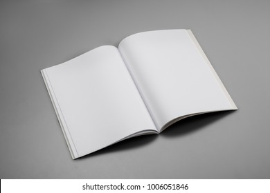 Mock-up magazine, book or catalog on gray table. Blank page or notepad on solid background for mockups or simulations.