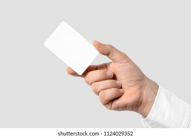 Mockup of male hand holding a Business Card isolated on light grey background. Rounded corner, Europe standard size 85×55 mm.