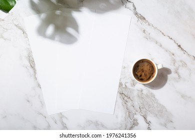 Mockup menu restaurant or coffee shop three narrow pages, coffee mug, shadow from plants on marble background
