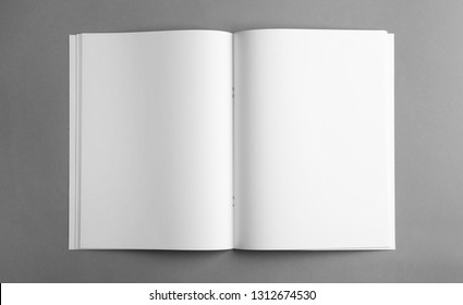 Mockup of open blank brochure on grey background, top view