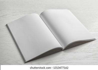 Mockup of open brochure on wooden background