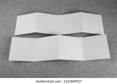 Mockup of opened four fold brochure at gray background