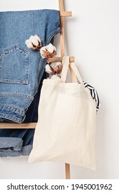 Mockup with organic cotton tote bag and jeans. Sustainable ethical consumption, zero waste, circular fashion concept