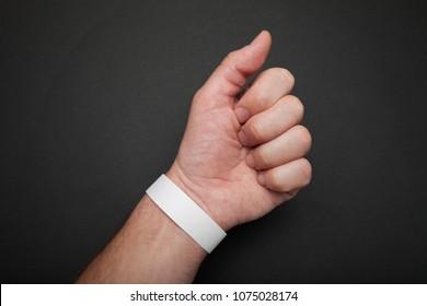 Mockup paper bracelet on the arm for concert or party.