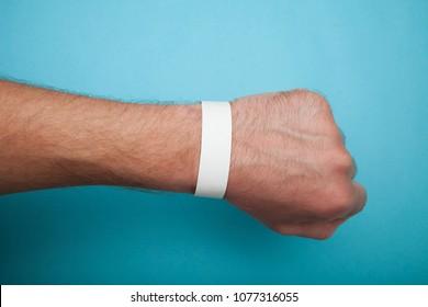 Mockup paper white bracelet on the arm.