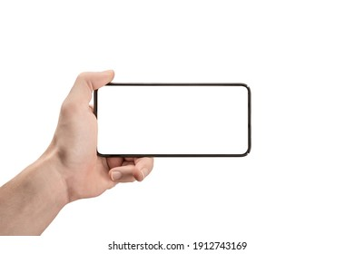 mockup phone horizontal. Hand Holding The Black Smartphone and Modern Frameless Design. Isolated man left hand holding black horizontal cellphone phone. watch tv streaming video movies online