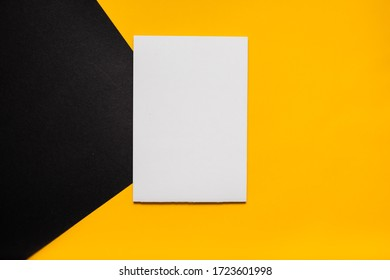 Mockup planner flat lay, top horizontal view yellow background. Notepad and notebooks with stationery. Golden, white and black colors. Back to school, education concept.