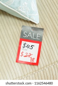 Mock-up of price tag showing reduced price of a discounted product on sale in a retail store. Priced in dollars for US market