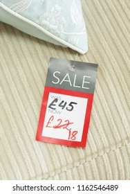 Mock-up of price tag showing reduced price of a discounted product for sale in a retail store. Priced in pounds sterling for UK market