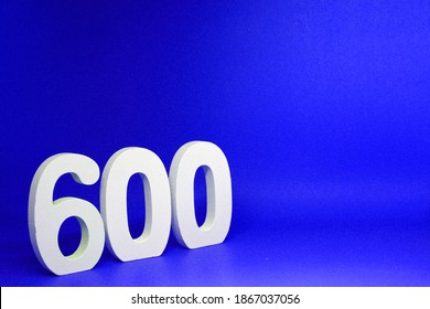 Mockup Six Hundred ( 600 ) white   number wooden  Isolated Blue Background with Copy Space - New promotion 600% Percentage  Business finance Concept