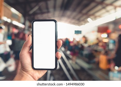 Mockup of smart phone black mobile phone with white screen,  railway Station Background