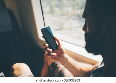 Mockup of smartphone in bearded man`s hand