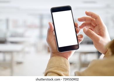Mockup smartphone blank screen in man hands over blurred background.