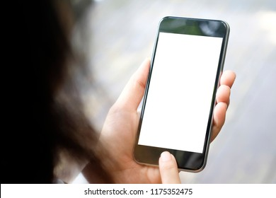 Mockup smartphone on female hands empty display.