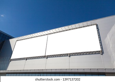 Mockup of street billboard on the facade of the exhibition complex, a huge banner ad, large format