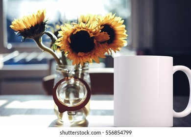 Mockup Styled Stock Product Image, white mug that you can add your custom design/quote to. White blank coffee mug next to a vase of sunflowers.
