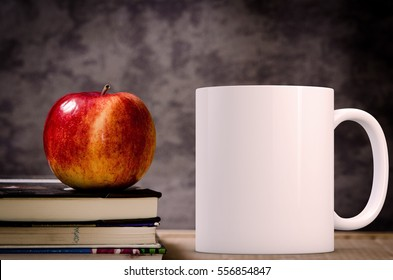 Mockup Styled Stock Product Image, white mug that you can add your custom design/quote to. Mug is next to books with an apple on them.