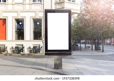 Mockup template of street lightbox stand signboard in the european city center.