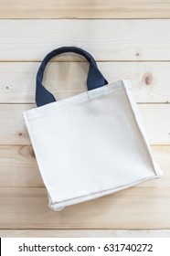 Mockup tote bag fabric cloth shopping sack on white wood