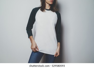 Mock-up of t-shirt long sleeve, pretty young girl wearing blank white t-shirt with green long sleeve