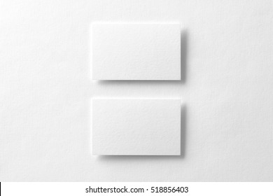 Mockup of two horizontal business cards at white textured background.
