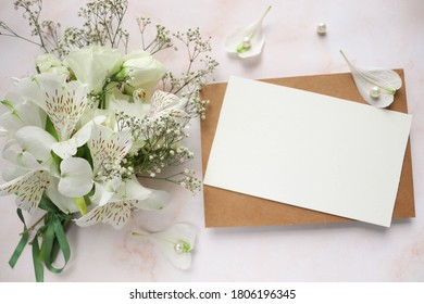 mockup wedding card. bouquet of white flowers on a white background and place for text. congratulation. invitation