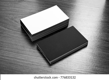 Mockup of white and black business cards at wooden background. Template for branding identity