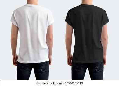 Mockup of a white and black T-shirt on a guy in black jeans. Template isolated on white background. Back view