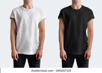 Mockup white and black t-shirt with rolled up sleeves. Template on a young guy isolated on a white background.