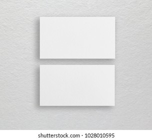 Mockup of white business cards at beige background. Template for branding identity