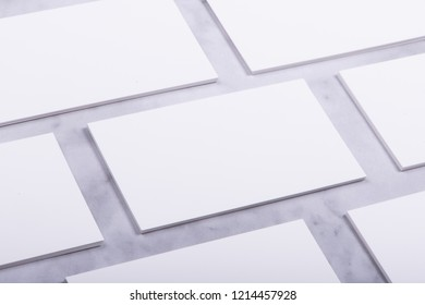 Mockup of white business cards stacks in a row on marble background, Ideals for presentation and design artwork