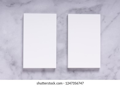 Mockup of white business cards stacks in a row on marble background, flat lay. Ideals for presentation and design artwork