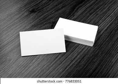 Mockup of white business cards at wooden background. Template for branding identity