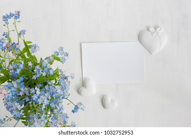 Mockup white greeting card with blue flowers and light background